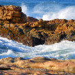 Stock Photo: Oceswirling through rocks