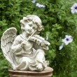 Figurine of angel playing violin — Stock Photo #3699656