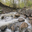 Stock Photo: Rushing River Water Over Rocks
