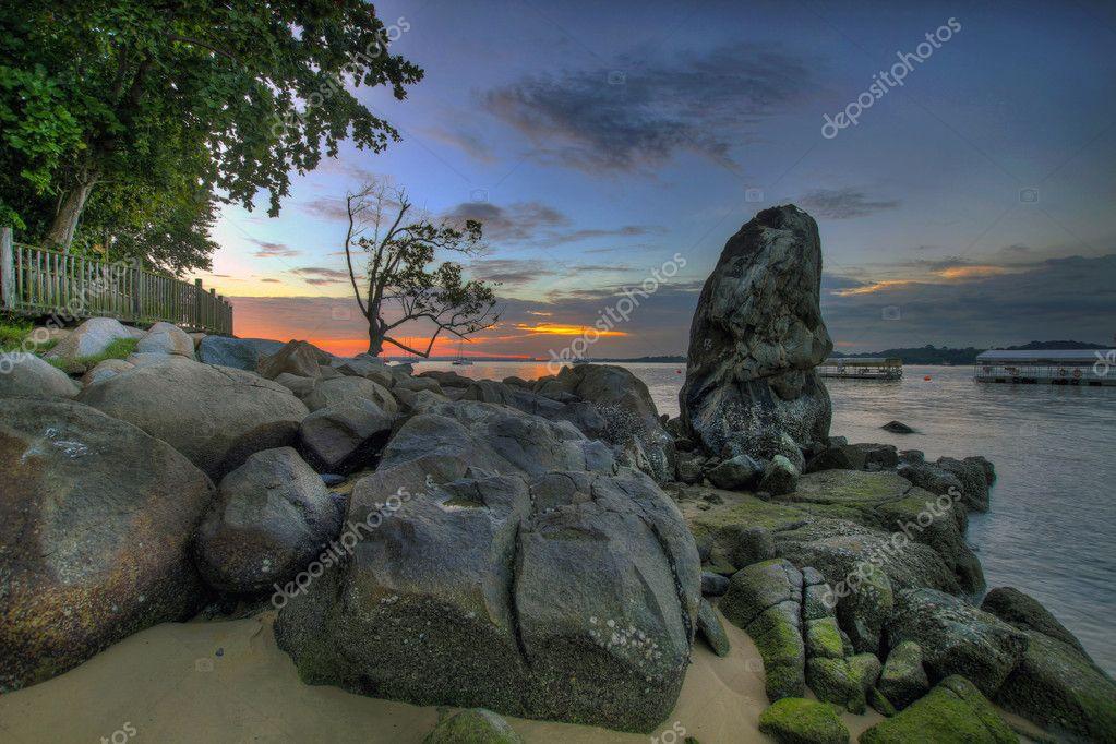 考边��y�#�.b9c�_海沙滩在樟宜点新加坡 3 日落C 图库图片
