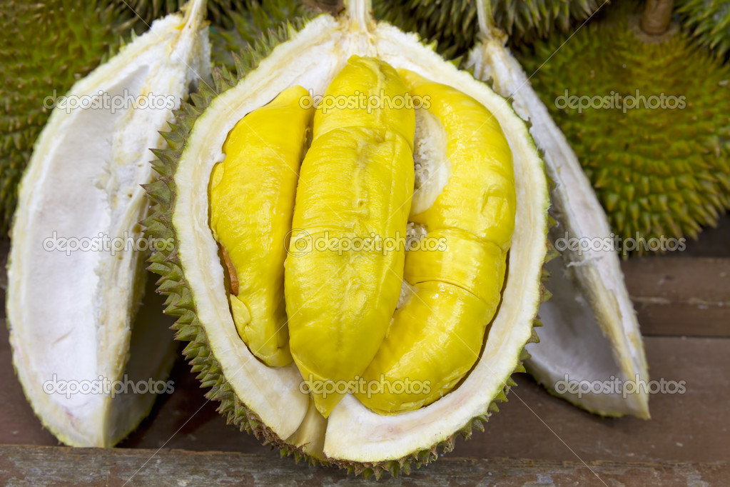  Durian open in display with yellow flesh on fruit stand in tropical country  Stock Photo #3867254
