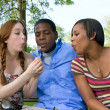 Three friends in the park - Stock Photo