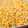 Uncooked macaroni — Stock Photo #3552355