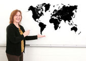 Teacher and map — Stock Photo