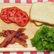 Blt ingredients on a cutting board — Stock Photo