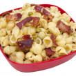 Shell pasta with bacon and peas — Stock Photo