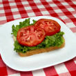 Slice of bread, lettuce and tomato - making a blt — Stock Photo #3588961
