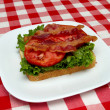 Bacon, lettuce and tomato on bread - making a blt — Stock Photo #3588963