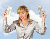 Successful businesswoman against the sky — Stock Photo