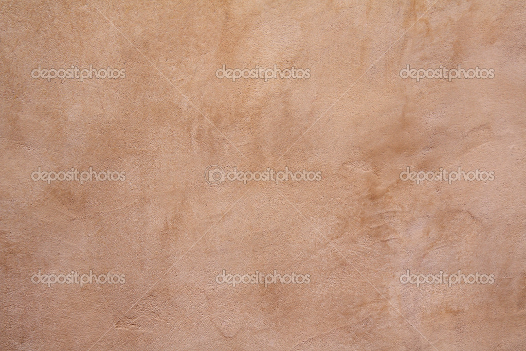 Full-frame view of a tan concrete wall background — Stock Photo #3045973