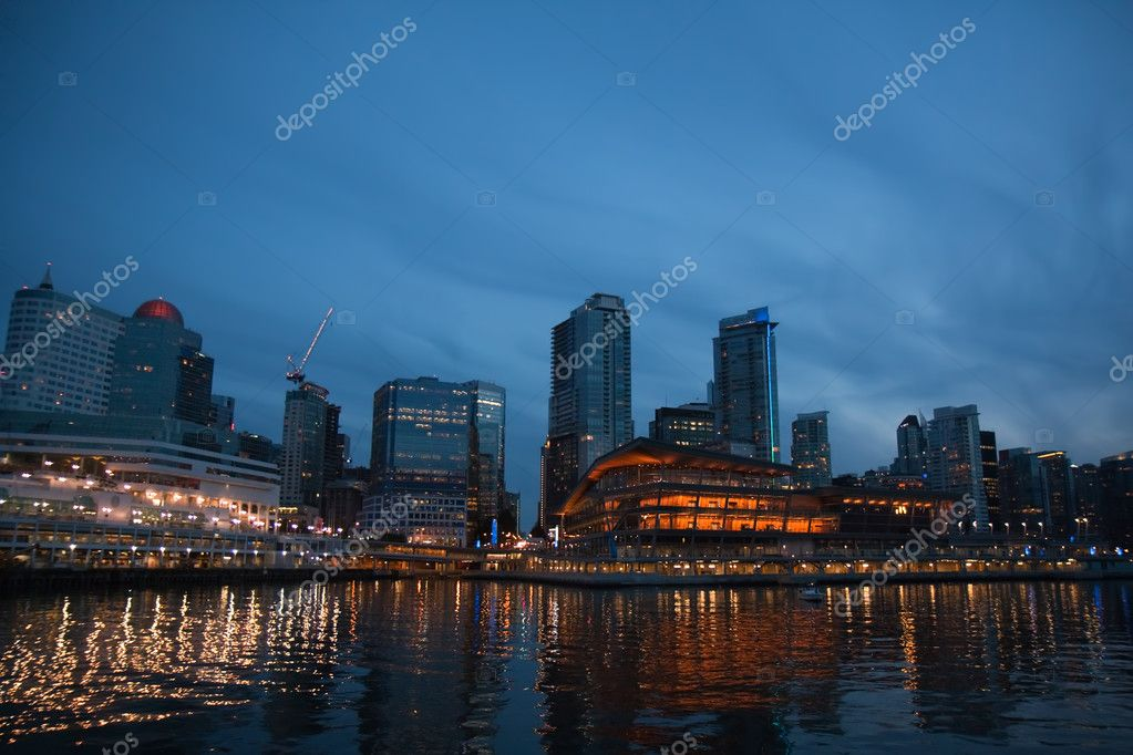 The skyline of Vancouver, British Columbia, Canada, with reflections on the water against a dramatic blue sky at night — Stock Photo #3806214