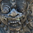 Stone carving face of god   in Bali - Stock Photo