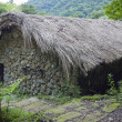 Stone house with Straw roof - Stock Photo
