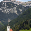 Church in the mountain village — Stock Photo