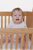 Little Baby Girl in Crib — Stock Photo