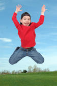 Little boy jumping in air — Stock Photo