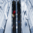 Motion blurred on escalator — Stock Photo