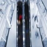 Motion blurred on escalator — Stock Photo #2748177