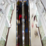 Motion blurred on escalator — Stock Photo