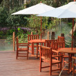 House patio with table and chairs under umbrella — Stock Photo #2749008