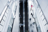 Motion blurred on stairs and escalator — Stock Photo