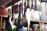 Brushes in the souvenir shop — Stock Photo