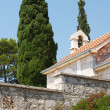 Stock Photo: Chapel belfry and cypresses