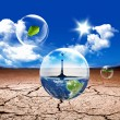 Stock Photo: Earth in water bubble
