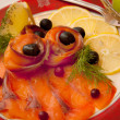 Foto de Stock  : Fillet of salmon with lemon and olives