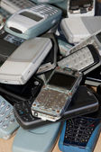 Close-up on an old mobile phones stack — Stock Photo