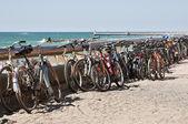 Many bikes on the beach — Stock Photo