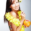 Stock Photo: Beautiful girl drinking grapefruit