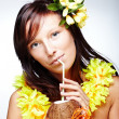Beautiful girl drinking coconut — Stock Photo