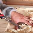 Hands in wood work - Stock Photo
