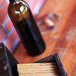 Bottle of wine and cigars — Stock Photo