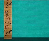 Flower bamboo banner on aquamarine ribbed wood — Stock Photo