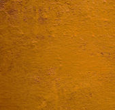 Orange and red painted wall background — Stockfoto