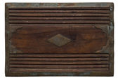 Carved wooden panel with distressed stained metal — Stock Photo