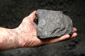 Coal in miner's hand — Stock Photo