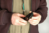 Mobile phone on leash — Photo