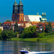 Stock Photo: River, motorboat and a cathedral church