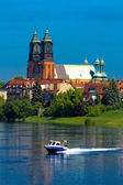 River, motorboat and a cathedral church — Stock Photo
