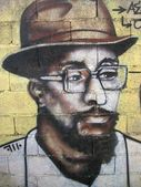 Graffiti - the black man with hat and glasses — Stock Photo