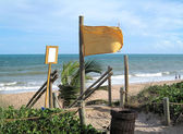 Yellow warning flag at the beach — Photo