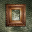 Golden frame over wallpaper — Stock Photo