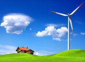 New house and wind turbine — Stock Photo