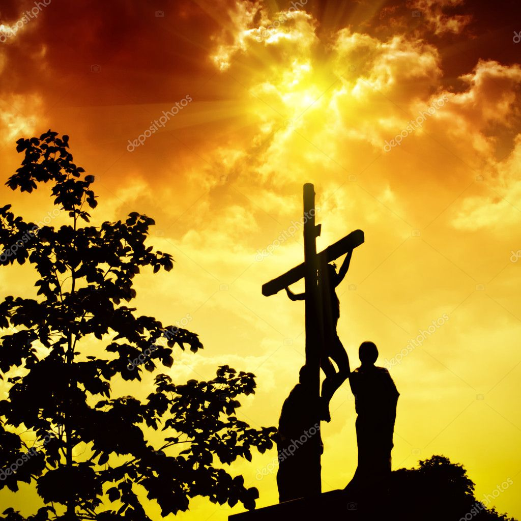 Crucifixion of Jesus Christ with dramatic sky in background  Stock Photo #2747814