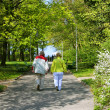 Senior couple walking at the park - Stock Photo