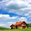 New house on cloudy sky — Stock Photo