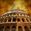 Royalty-Free Stock Photo: Colosseum on antique background